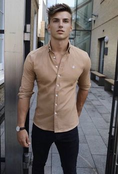 Summer style inspiration with a beige button up shirt with rolled up sleeves black denim black leather banded watch. model unknown #summerstyle #summeroutfits #denim #menswear #menstyle #mensfashion