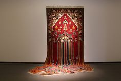Faig Ahmed recreates traditional rugs with technological glitches.