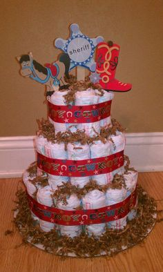 Cowboy Diaper Cake Cowboy Diaper Cakes, Diaper Cake Boy, Nappy Cakes, Cowgirl Baby Showers, Cowboy Baby Shower, Baby Boy Shower, Baby Shower Crafts, Baby Shower Themes, Shower Ideas