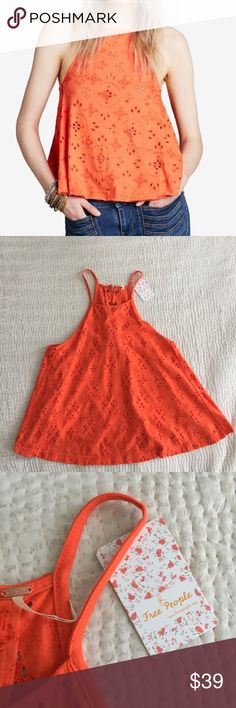 NWT Free People Tank 100% Cotton - Blogger Fav With a silhouette designed to sway, Free People's trapeze tank is perfect for the season's boho looks. High halter neckline Pullover styling Sleeveless Lace-up ties at back Allover eyelet fabric A-line silhouette Unlined Hits at high hip Cotton Machine washable Imported Free People Tops Tank Tops