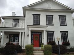 Looking for examples of farm house style with no shutters and dark trim on a white house. Like this with the red door. House Envy: White on White on White White Exterior Houses, Colonial Exterior, Exterior Trim, House Paint Exterior, Exterior House Colors, Black Trim Exterior House, Cottage Exterior, White Siding, Black Shutters