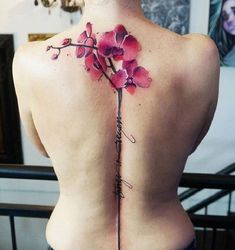 Back to Spine Orchid Tattoo. This spine tattoo is giving us serious tattoo goals!