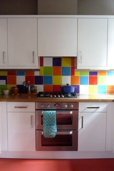 "Sneak Peek: Best of Rainbow Colors. ""If you can't decide on one tile color, why not just go with all of them? The look works in Megan Price and Robert Shadbolt's kitchen because everything else is kept neutral."" #sneakpeeek #rainbow"