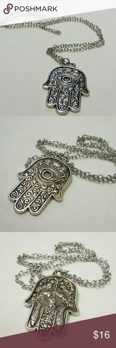 "*clearance* Hamsa pendant necklace Stunning double-sided Hamsa hand pendant on a long ball chain. Amazing detailing throughout, with evil eye and lion designs on the front and dainty images of birds, fish, grapes, and pomegranates on the back . This listing is for the silver necklace. The metal on this pendant has a vintage patina to it, and is made of good, solid materials.  Great for boho mystic hippy look. chain: 28"" pendant: 2.75"" by 1.25"" Wild Rose Boutique  Jewelry Necklaces"
