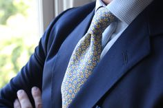 Liberty fabric floral pattern tie (made for Jcrew), navy suit, light blue gingham shirt.