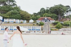 Image by Dorset Wedding Photographer Paul Underhill - DIY Wedding On The Dorset Coast With Bride In Homemade Dress With A Pale Pink And Blue Colour Scheme And Groom In Tommy Hilfiger Suit