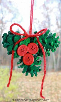 Pine cone holly ornament. Winter and Christmas arts and crafts for kids and preschoolers. Nature and button crafts. Painted pinecones