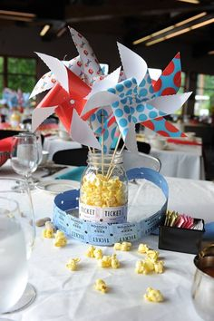 Used pinwheels in mason jars as center pieces for carnival themed bridal shower...suoer easy cheap and awesome!