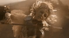 """I hadn't heard of musician Lindsey Stirling before her new video for """"The Arena,"""" but she appears to have cornered the market on violin-infused electronic music. She also dances better while wielding a violin than most people can with nothing in their hands. And she seems to be a Mad Max series fan."""
