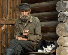 Russian man with cat.  Great candid shot even though it's a bit blurry.  It tells a story.