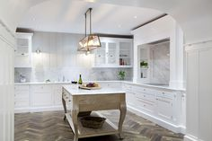 Our new signature range of Luxury kitchens that we proudly call Louis XVI. Crisp white colours with white washed oak Belgian themed island design.