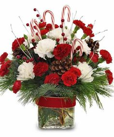 Make this holiday season a special one with Marco Island Florist's festive floral arrangements. Choose from any of our beautiful holiday flower bouquets in a price range comfortable for you. Christmas Flower Arrangements, Christmas Flowers, Christmas Table Decorations, Floral Arrangements, Christmas Wreaths, Holiday Decor, Christmas Floral Designs, Deco Floral, Flower Delivery