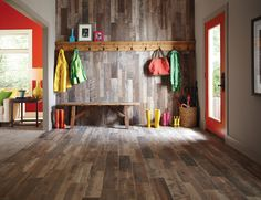 Get the look of reclaimed wood with the durability of tile. Wood tile is perfect in an entryway or mud room, since it can handle moisture and cleans up quickly. See more reclaimed wood tile.