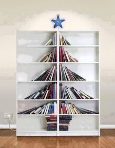 Bibliophile's Christmas ~ Christmas tree with books in bookself.