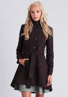 This soft and thick aubergine-colored coat is a cold weather must-have with its standing collar and a back pleat with an elliptical high-low hem. Finished with front button closures and a self-ti...