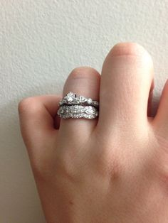 It was tough to find a ring to match my beautiful heirloom engagement right, but I think the top ring balances it out nicely. They look like they would have gone together!