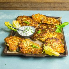Cheesy Zucchini and Corn Fritters with Herb Sour Cream