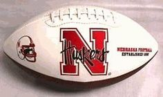 NCAA Nebraska Cornhuskers Signature Full Size Football by Licensed Products. $25.00. Comes with an autograph pen.. Nebraska Cornhuskers embroidered team logo displayed on front and school wordmark on back.. 3 smooth white panels for autographs.. This collegiate classic team football features an embroidered team logo prominently displayed on the front and the school wordmark on the back.  An autograph pen is included with each ball and the 3 smooth white panels provide ...