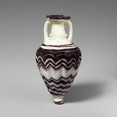 Glass amphoriskos (perfume bottle) Period: Classical Date: late 6th–5th century B.C. Culture: Greek, Eastern Mediterranean Medium: Glass; co...