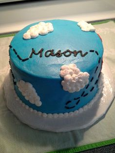 "Cake with ""vintage plane' theme for first birthday party! All buttercream, four-layer cake was chocolate/vanilla swirl. Letters were frozen buttercream transfer, as I do not have "" good handwriting"" with frosting, lol."