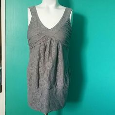 Grey lace tank top Perfect grey lace tank top. It's in great condition I wore this with a biker jacket and black skinny jeans. This would be perfect for a girls night out. Brand name is Max and it's a size medium. Tops Tank Tops
