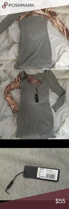 Kardashian Kollection Bodycon Dress NWT Kardashian Kollection Gray  & Bronze Long sleeve Bodycon Dress  One sleeve is sequined, one regular material. There is also sequin detail across the chest.  Low scoop back  Size small ***NWT***  Retail $109 Kardashian Kollection Dresses Long Sleeve