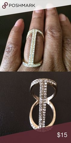 Fun funky Ring w/ crystals Gold tone fashion ring with pave style crystals. In new condition. Never worn. Size 7-7.5 and measures to the knuckle. Charming Charlie Jewelry Rings