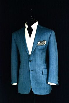 Blue Herringbone Sport Jacket, Notch, Flap Pockets. Linen, Silk and Wool Blend By Ariston. White Royal Oxford Buttoned Down. White and Navy Herringbone Silk Pocket Square, Hand Rolled In Japan. Hand Made by Manolo Costa, New York