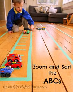 Using a painters tape racetrack to sort upper and lowercase letters makes learning the alphabet a blast!  Such a fun way teach kids the ABCs!