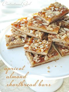 Apricot Almond Shortbread Bars. Apricot preserves, orange liqueur, butter, sugar, almond extract, orange zest, flour, salt, and sliced almonds.