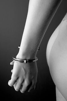 Hands of a woman in Handcuffs Close Up.