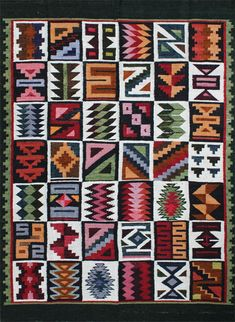 "rug #: 2-103  type:   Peruvian Weaving  origin: Peru  size: 3'10"" x 5'2""  This geometric rendering of a traditional Inca calendar design is beautifully executed with an amazing choice of mature colors on a white and earthy green ground.  This one of a kind work of art is all handmade with natural materials and vegetable dyes, and was purchased directly from the artisan who produced it."