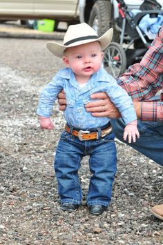 Cowboy hat, Cowboy boots, jeans, button down western shirt, and leather belt. We got the real deal here! This lil' Cowboy is gonna melt all the Cowgirls hearts!