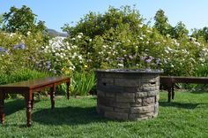 Fire Pit & Benches make a great conversation area by Casi Cielo Events & Flowers