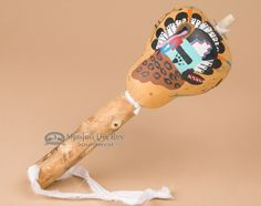 This is a an authentic Native American Zuni gourd rattle. This gourd shaker is…