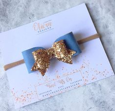 This beautiful autumn bow is made with Blue Leatherette and little sparkles Gold glitter fabric on an alligator clips or Nude nylon headband Bow measures approx. 3.15 inches. Nylon headbands are super soft and one size fits all. S A F E T Y -------------- Our items are for