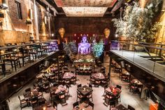 Asian style and food temple in NY...  Tao Restaurant in New York. It's in what used to be the stable for the Vanderbilt family in the 1800's. Try the Pad Thai, with rice noodles, chili peppers, lime, garlic,bean sprouts, and grilled shrimp.