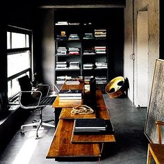 The desk is interesting and I like the look of the black shelving.
