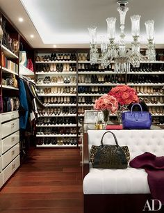 Installed floor-to-ceiling shelving to store an extensive collection of shoes.