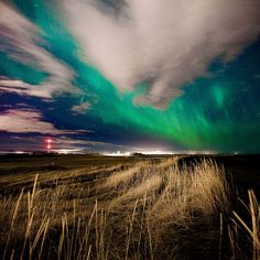 Aurora borealis: pictures of the northern lights in Iceland by photographer   Kristjan Unnar Kristjansson.