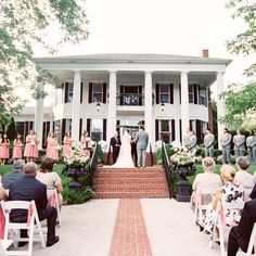 Outdoor ceremony in Hogansville, GA. MyLife Photography. More: http://www.theknot.com/weddings/album/a-simple-modern-wedding-at-victoria-belle-mansion-in-hogansville-georgia-171904
