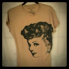 Lucille Ball tissue tee w/ faux rhinestone detail High neck tissue weight tee with Lucille Ball graphic and faux rhinestone earing detail. Never worn.  100% cotton Tops Tees - Short Sleeve
