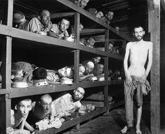"""H.E. Miller, U.S. Army Signal Corps Barack 56, Buchenwald Concentration Camp, Near Weimar, Germany 1945 Elie Wiesel is the prisoner on the second row of bunks, seventh from the left. """"No one is as capable of gratitude as one who has emerged from the..."""
