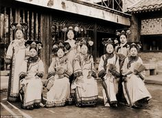 'Ladies of the Palace' photographed by Frank Carpenter and his daughter Frances. The picture shows the rich detail of court fashion during the last years of the Manchu Qing dynasty