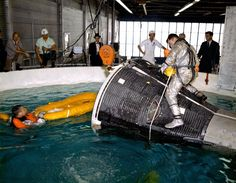 February 5, 1965: Great image of Gemini 3 water egress training. John Young sits atop the capsule