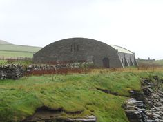 Exterior of Structure Covering Midhowe Chambered Cairn, Rousay, Orkney, Scotland (J. Demetrescu 2007) | Originally built ca.3500 B.C. and discovered in 1932 by a landowner, the huge Midhowe Chambered Cairn is over 75 feet long and is divided by pairs of upright slabs into 12 compartments, several of which contained stone benches. The remains of 25 people were found in the compartments, and pottery was also recovered.