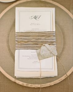 pretty fabric pattern wrap + tie with a zinc place card tag.