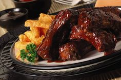 Brown sugar, paprika and garlic come together for a tantalizing ribs rub that's finished off with sticky BBQ sauce and a splash of bourbon.
