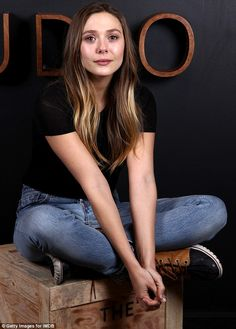 Boxing clever: Elizabeth Olsen looks stunning as she sat on a crate at theSundance Film Festival on Sunday