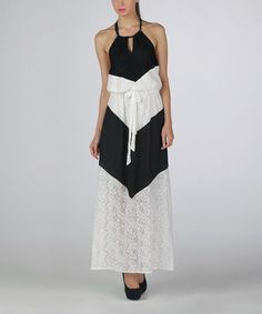 Occasionally, an evening on the town requires a little elegance. A flowy, lace-bedecked frock boasts a color block design, while a halter neckline completes this chic look.
